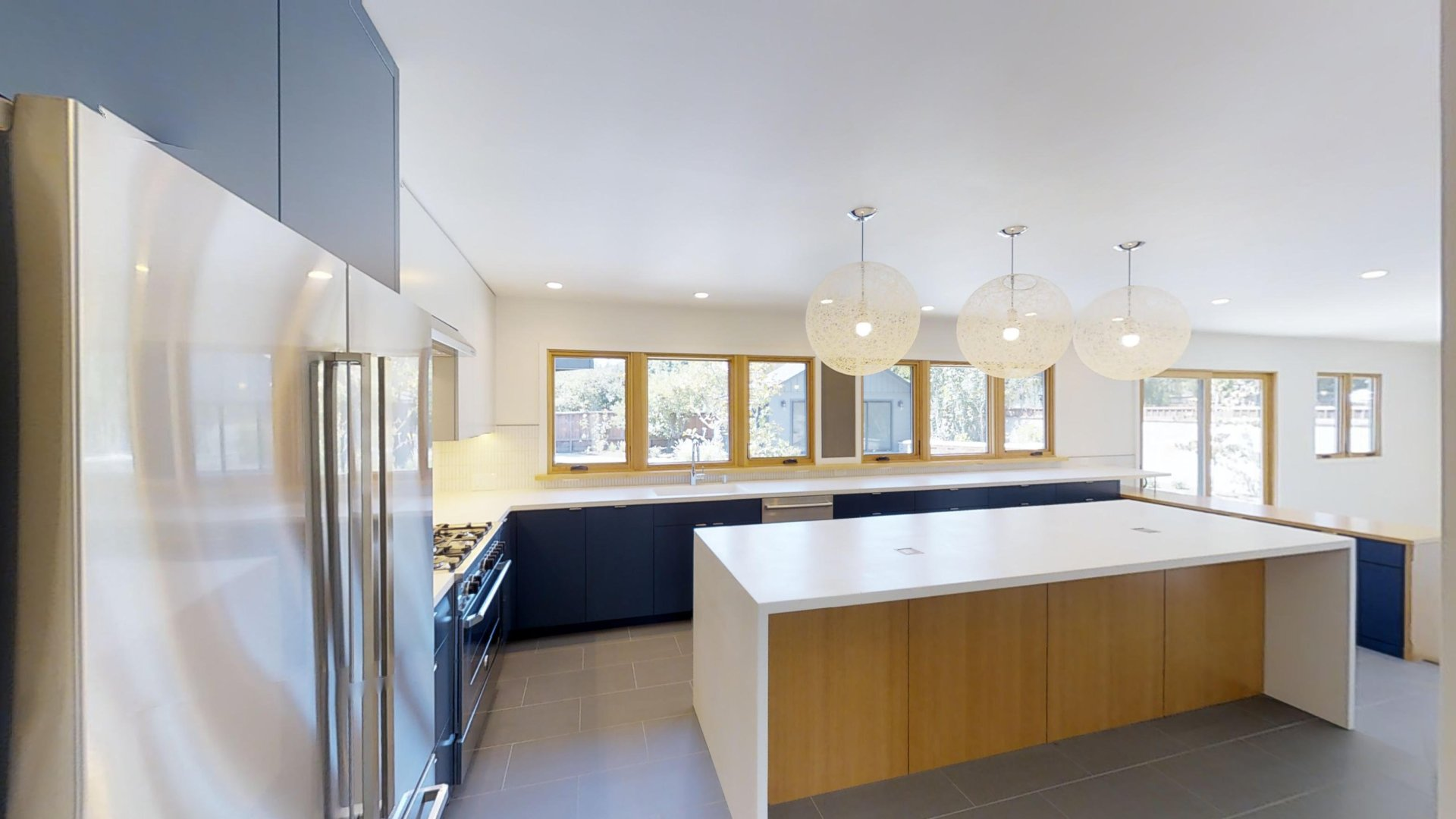 A large white modern kitchen, like one you might find in a property managed by Alliance for Sonoma County Property Management